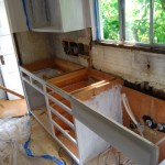 Ta Da! Sink and counter out. This is rock-bottom and looks it. Note the irregular hole on the other side of the window. Solving that little problem took a while. Really, all the holes presented interesting little puzzles.